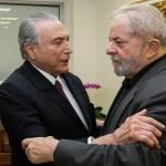Brazil's President Temer embraces former Brazilian president, Lula da Silva, in tribute to Marisa Leticia, the wife of Lula da Silva at Sirio Libanes Hospital in Sao Paulo